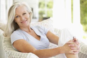 woman smiling on a sunlit porch