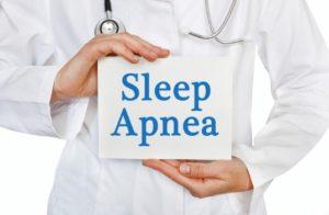 Doctor holding sleep apnea sign