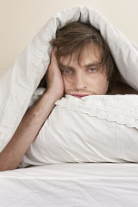 man frustrated can't sleep