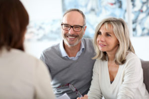 older couple discussing with a professional