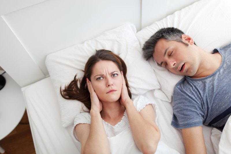 wife upset with husband for snoring
